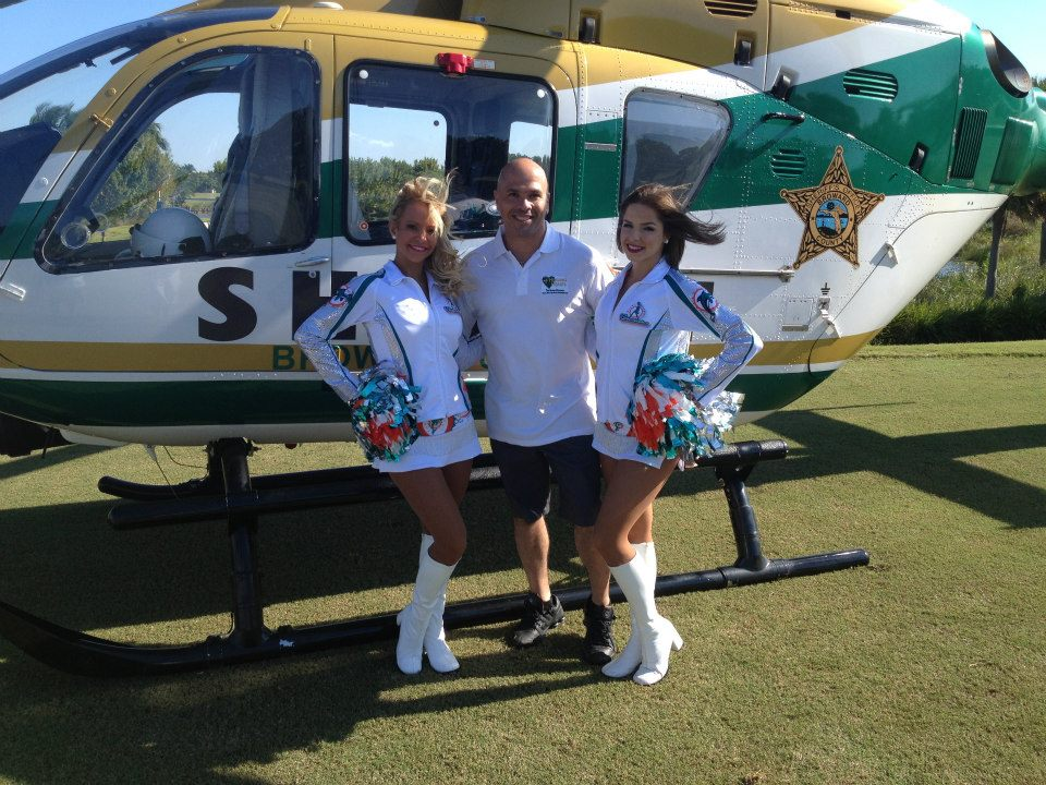 2012-healing-hearts-dinner-golf-tournament-sergio-with-dolphin-cheerleaders
